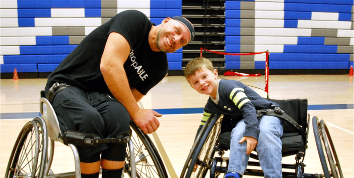 Wheelchair-bound athletes on the basketball court at The Ability Center.